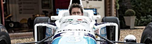 James Martin, TV chef sat in his new Benetton F1 car, previously raced by Jean Alesi